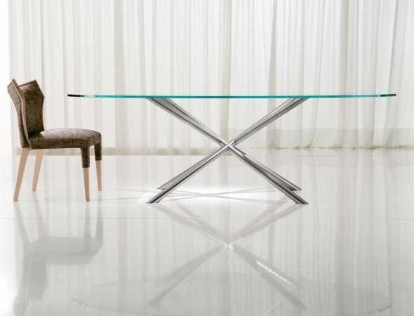 שולחן אוכל עגול בעל בסיס מתכת ומשטח עליון מזכוכית