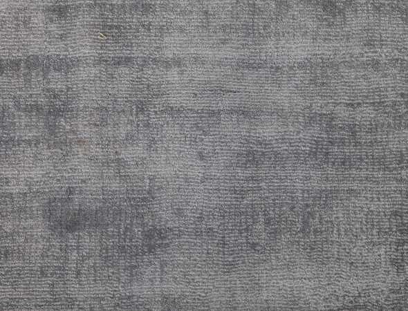 שטיח שטוח, עדין וצפוף העשוי מחוטי משי טנסל דקים במיוחד. עדינות החוטים והברק הרך האופייני להם, יוצרים מרבד מודרני ומרשים מאוד שפניו משתנים עם כל נגיעה ועם כל משב רוח.סיב הטנסל נפרד מסיבי ויסקוזה אחרים בכך שכמות הקישורים הפנימיים היא כפולה מבשטיחי ויסקוזה אחרים.ולכן השטיח אינו נפגע מניזקי מים כמו שטיחי ויסקוזה אחרים. קיים בגוונים רבים ונמצא גם במידות גדולות