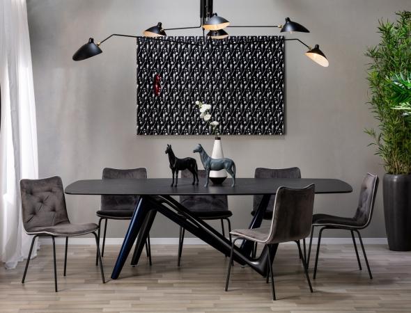 שולחן-אוכל-דגם-משטח-עליון-קרמיקה-שחורה-ורגלי-טיטניום-מעוצבתESSE